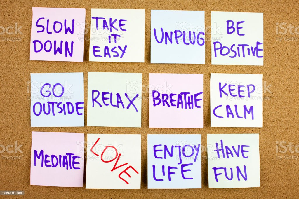 A yellow sticky note writing, caption, inscription Slow down, take ir easy be positive go outside relax breathe keep calm love what you do, do what you love, motivational concept on sticky notes stock photo