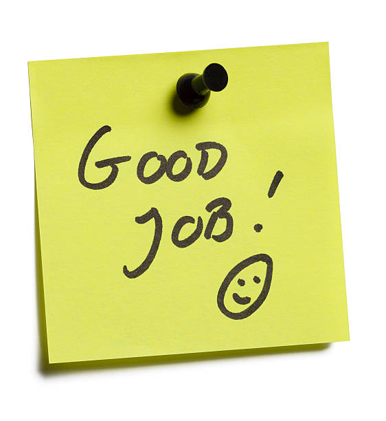 Yellow sticky now reading good job with thumbtack on top stock photo
