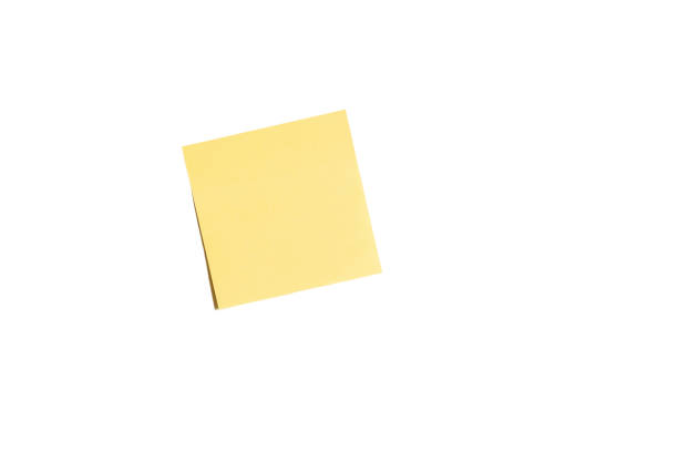 yellow sticky paper notes isolated on white background - post it notes стоковые фото и изображения
