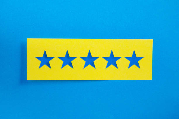 Yellow Sticky Paper With 5 stars Message On Blue Background stock photo