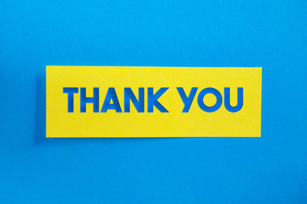 Yellow Sticky Paper With Thank You Message On Blue Background stock photo