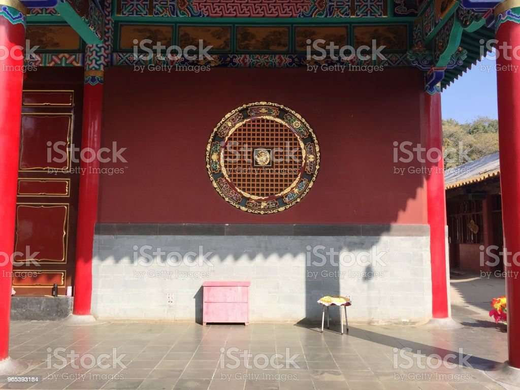 A yellow stool and a pink bedside table in the Buddhist Temple (Kunming, Yunnan, China) royalty-free stock photo