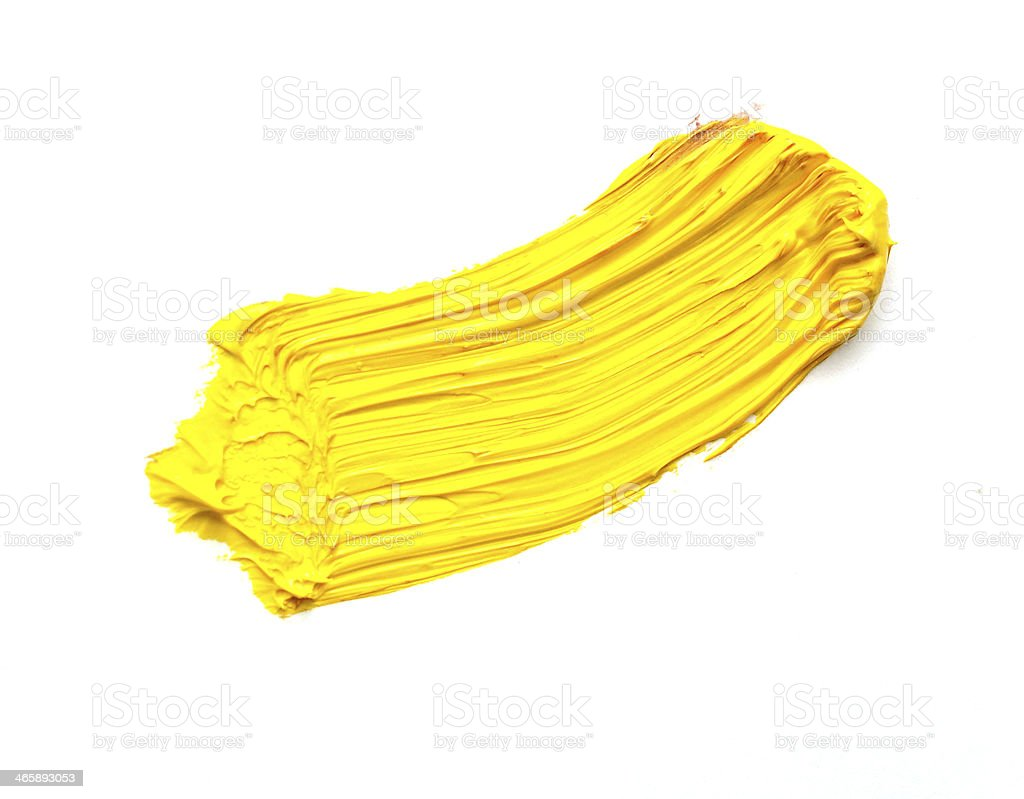 yellow stroke of the paint brush isolated on white stock photo
