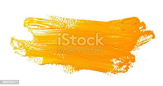 Ochre strokes of the paint brush isolated on a white