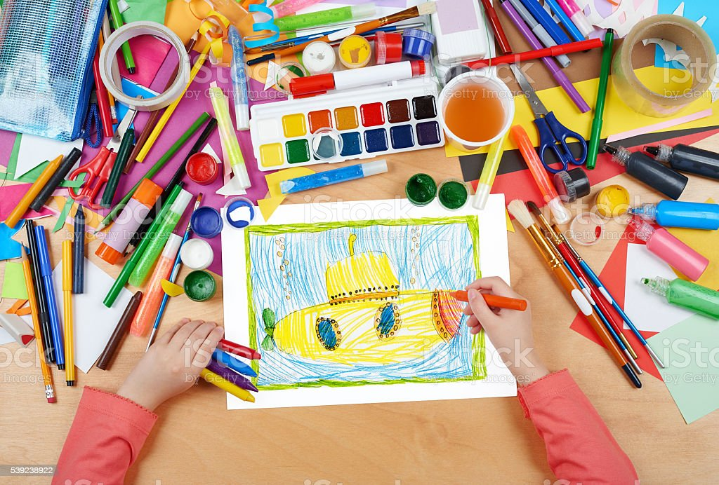 yellow submarine underwater child drawing, top view hands royalty-free stock photo