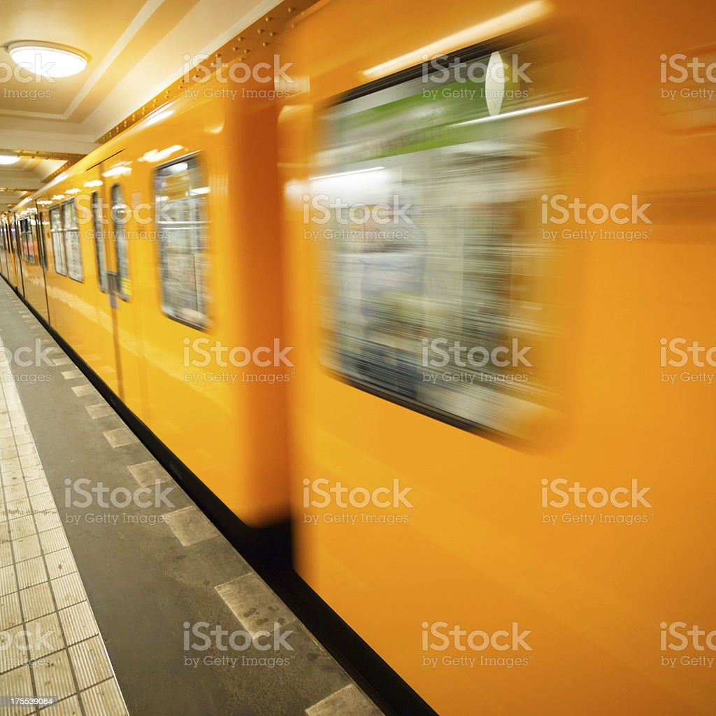 Yellow subway train in motion royalty-free stock photo