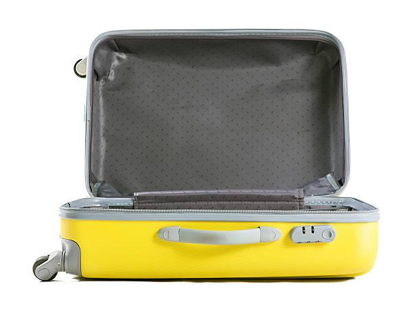 Gelben Koffer isoliert auf weiss – Foto
