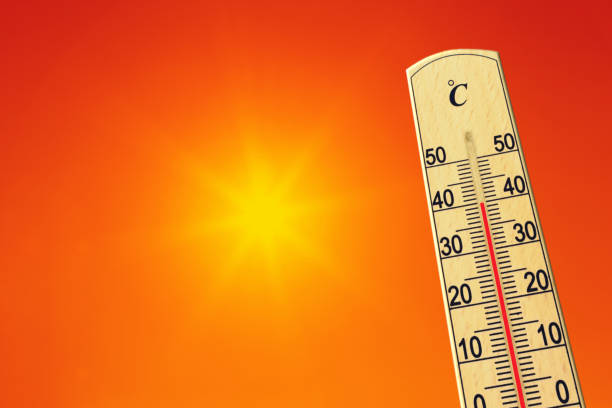 Yellow sun in red sky. Summer heat. Thermometer shows high temperature in summer. Ambient temperature plus 40 degrees stock photo