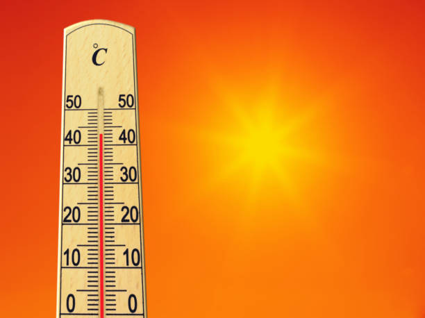 Yellow sun in red sky. Summer heat. Thermometer shows high temperature in summer. Ambient temperature plus 43 degrees stock photo