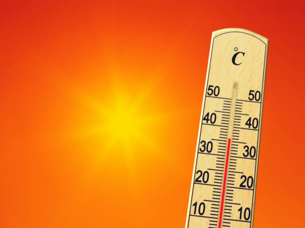 Yellow sun in red sky. Summer heat. Thermometer shows high temperature in summer. Ambient temperature plus 36 degrees stock photo