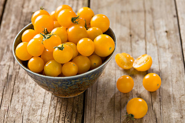 Yellow Sungold Cherry Tomatoes stock photo