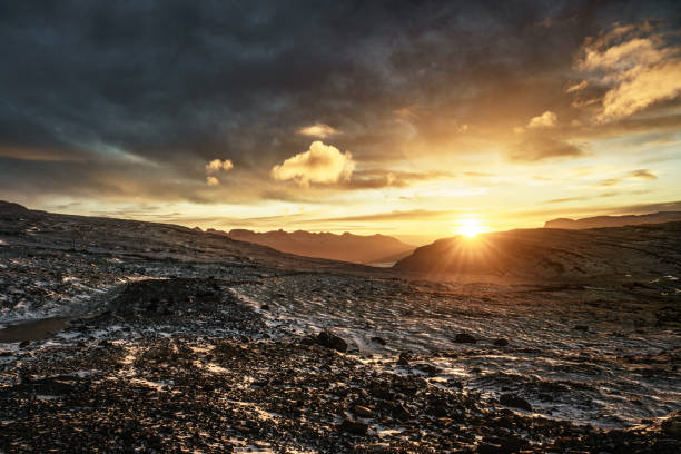 Yellow sunrise in Iceland in cloudy sky stock photo