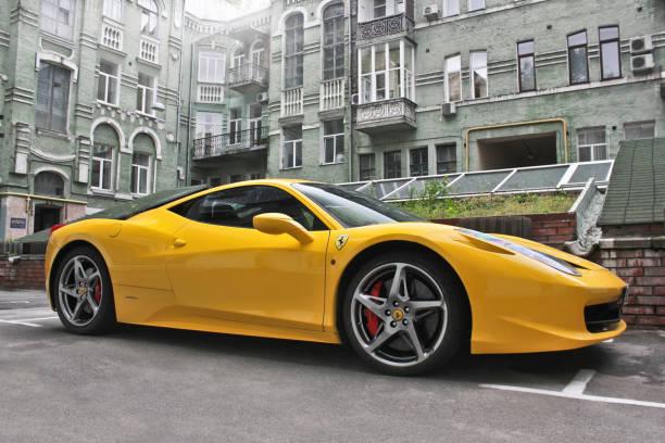 Yellow supercar Ferrari 458 Italia in the city stock photo
