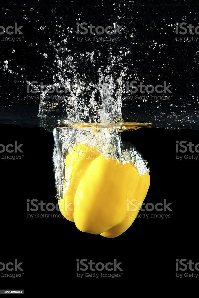 yellow sweet pepper drop into water 3 royalty-free stock photo