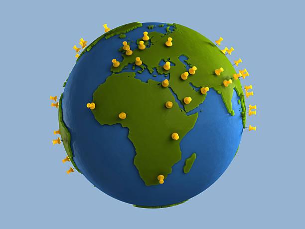 Yellow Tacks on Globe (Africa) stock photo
