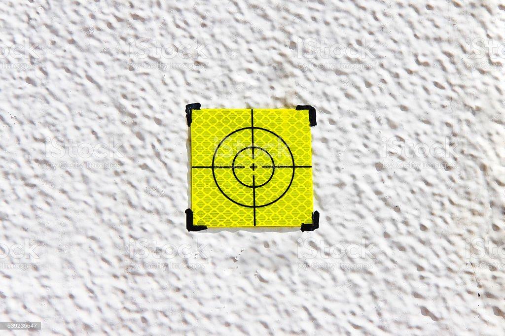 Yellow target point on white background royalty-free stock photo