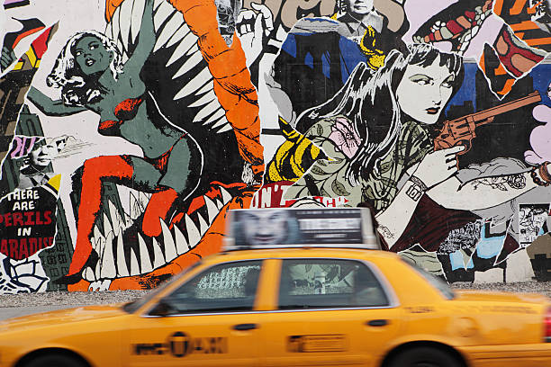 nyc yellow taxi and mural wall on houston street - lower east side manhattan stock pictures, royalty-free photos & images