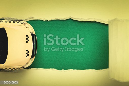912120622 istock photo Yellow taxi car and green banner sign. Top view 1202040603