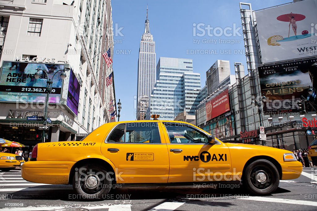 Yellow taxi in Manhattan, New York City royalty-free stock photo