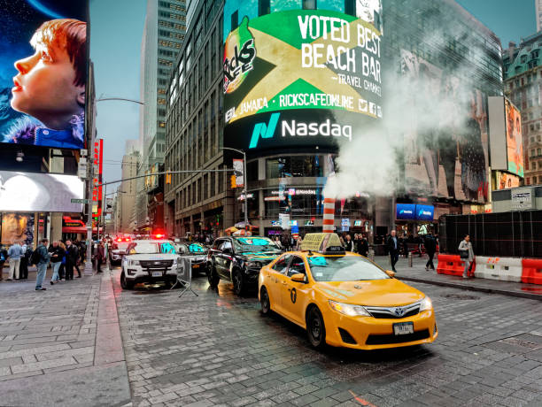Yellow taxi in Times Square Manhattan New York City USA stock photo