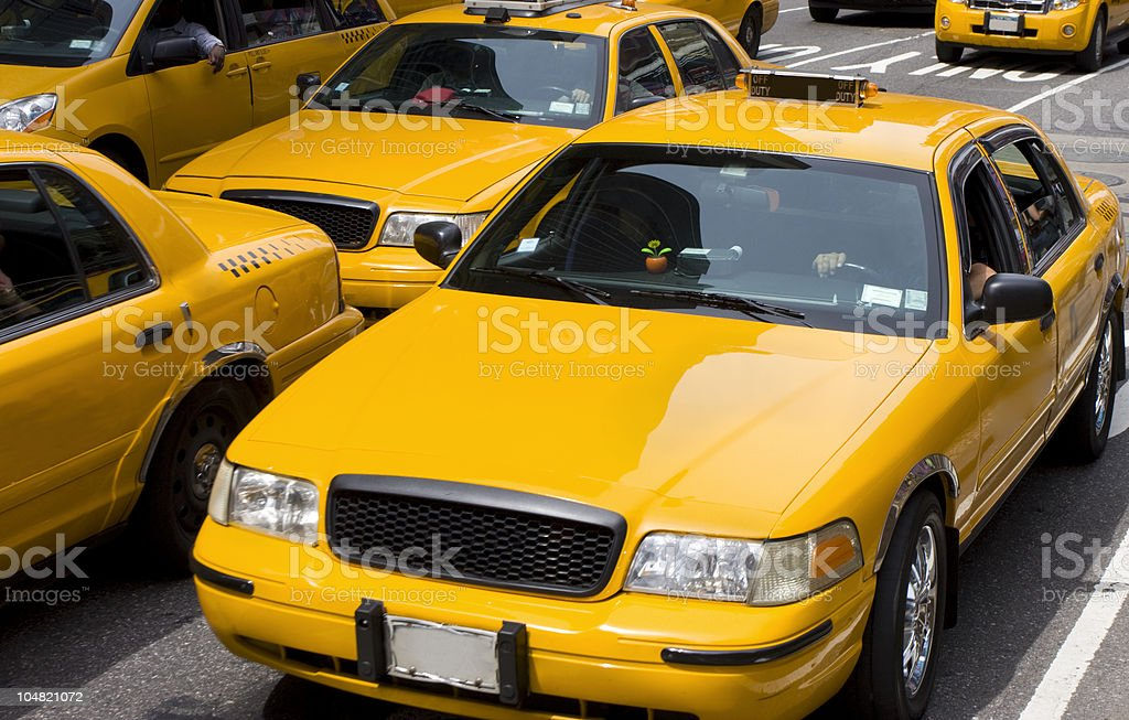 Yellow Taxi in traffic, New York City stock photo