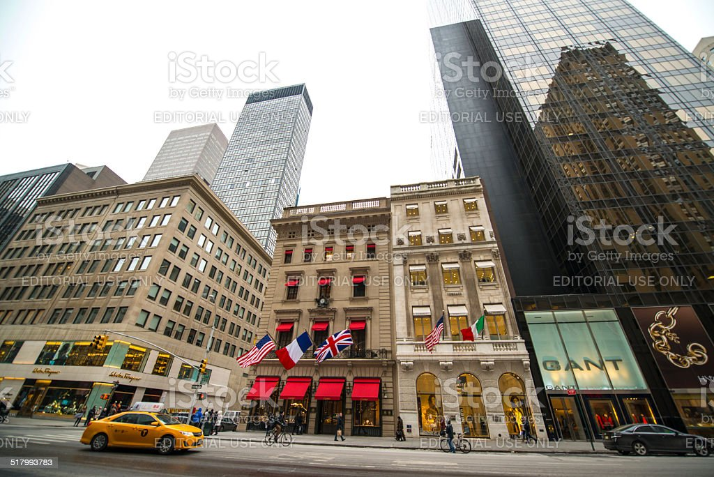Yellow taxi moving on 5th Avenue, NYC stock photo