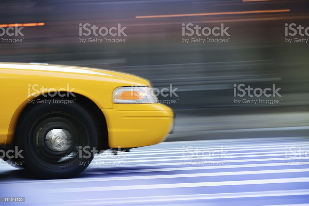 Yellow taxi on the streets of New York City royalty-free stock photo