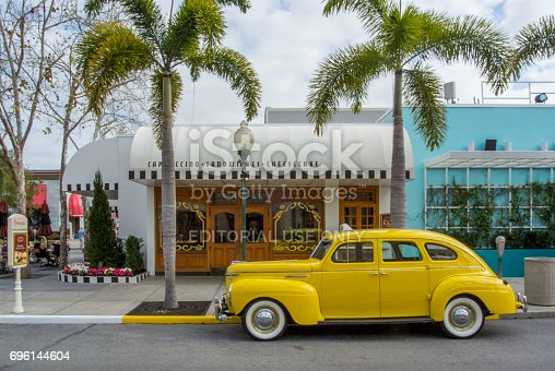 Orlando, Florida, USA - March 9, 2016: Vintage car parked on the roadside waiting for the guests, Classic cars are allowed to park at yellow line.
