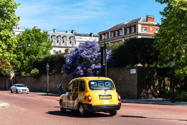Yellow taxi speed through Road in London stock photo
