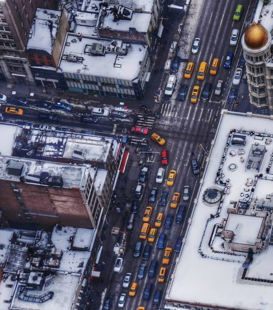 Yellow Taxis on a Snowy Day on a New York City Street stock photo