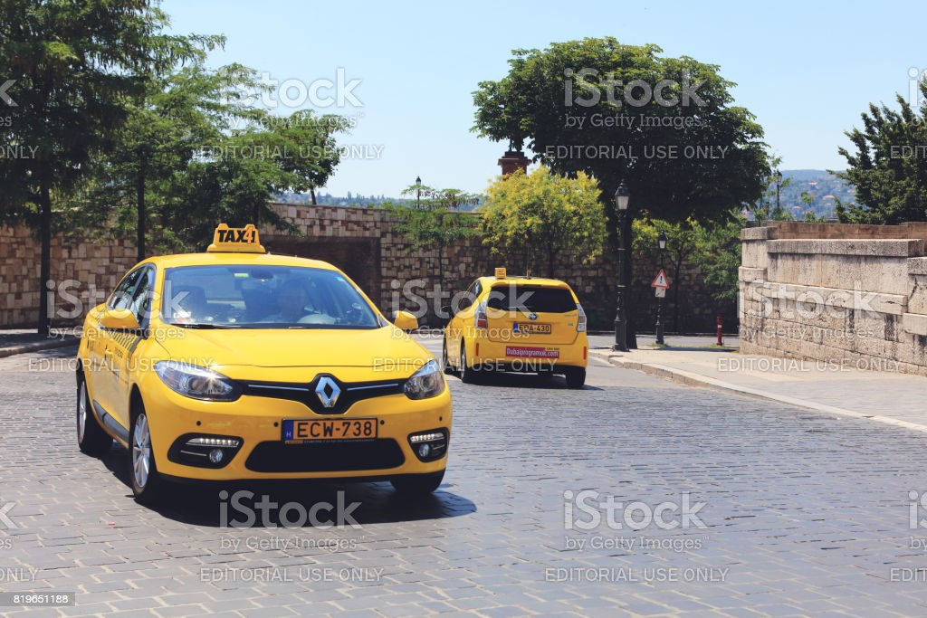 Yellow taxsi in central Budapest side street stock photo
