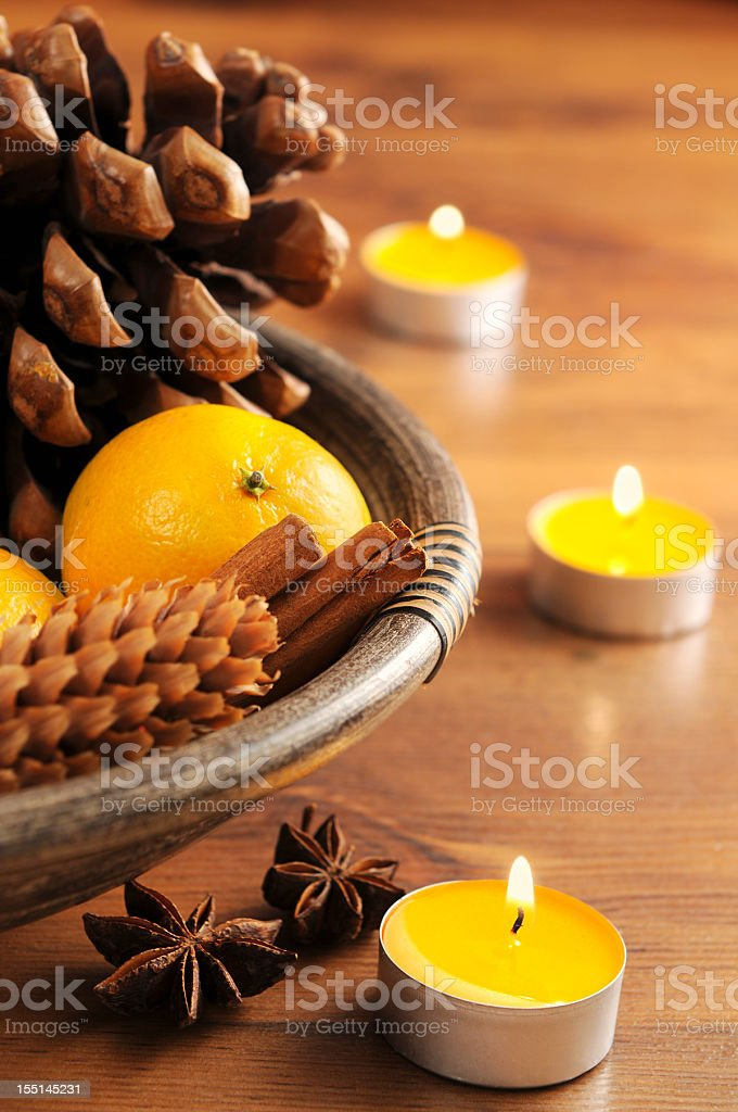 yellow tea light and natural Christmas decoration royalty-free stock photo