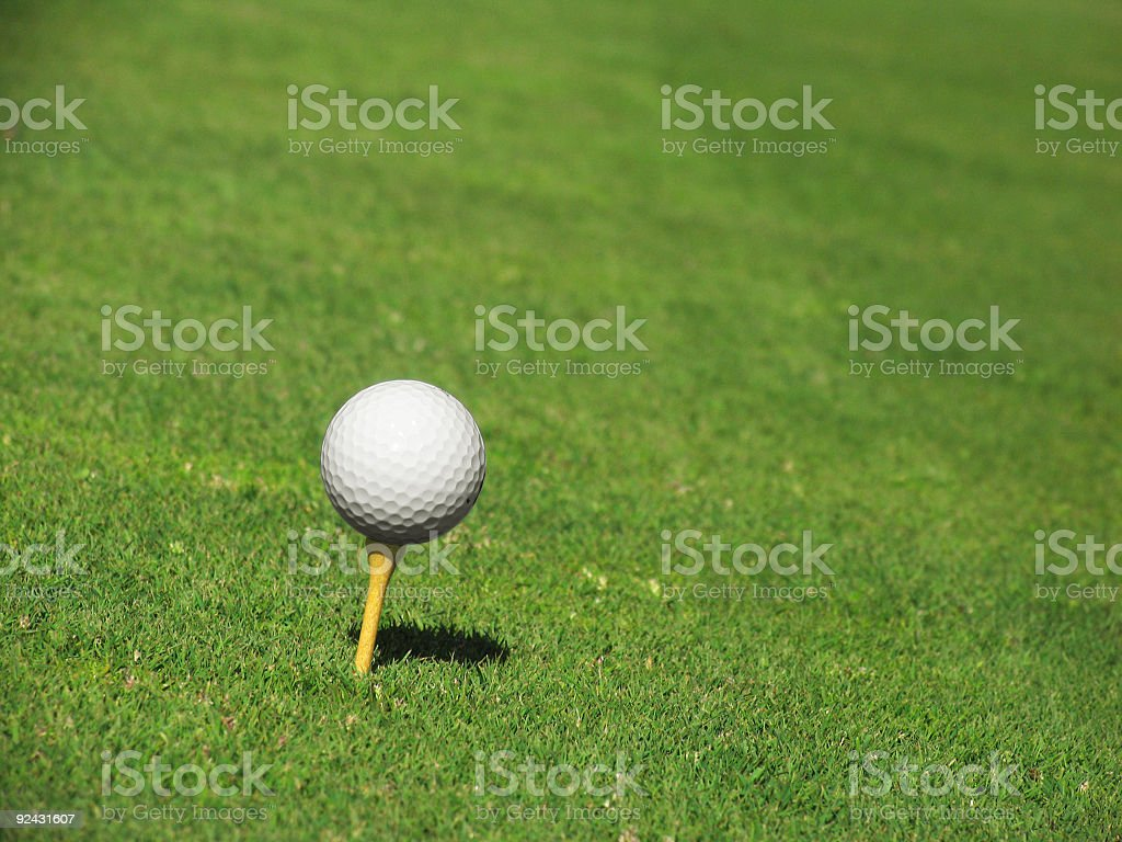 Yellow Tee with Golf Ball royalty-free stock photo