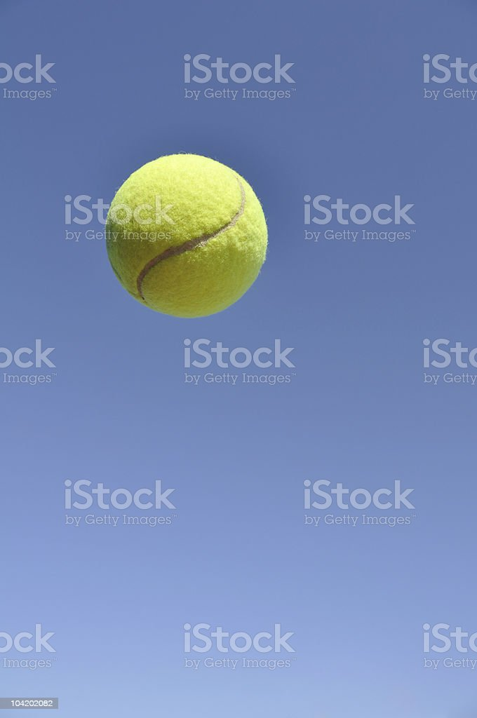 Yellow Tennis Ball in the Air royalty-free stock photo