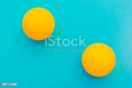 istock yellow tennis ball on a blue background 697127896