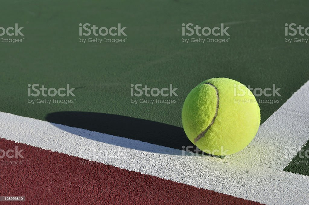 Yellow Tennis Ball on Court stock photo
