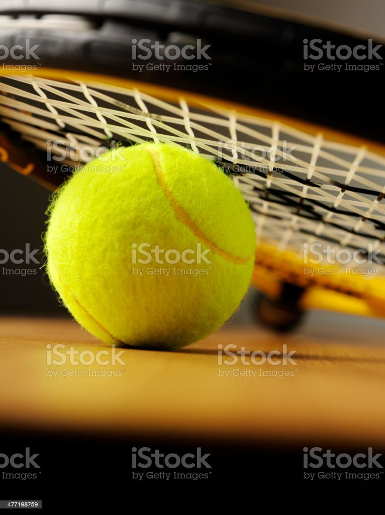 Yellow Tennis Ball with a Racquet royalty-free stock photo