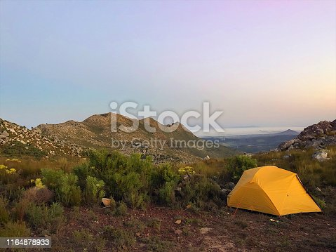Yellow Tent pitched on top of a mountain with Botmaskop in the background above Stellenbosch Cape Town South Africa