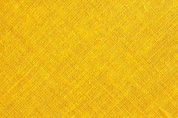 黄色の布地の背景。 ストックフォト