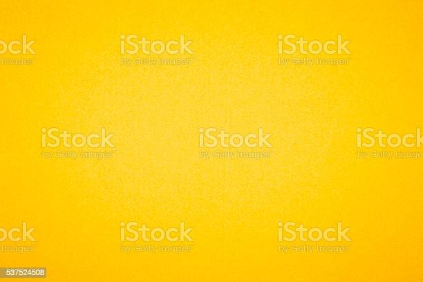 Yellow textured paper background.