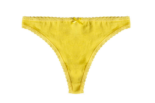 Yellow thongs Yellow cotton thongs on white background panties stock pictures, royalty-free photos & images