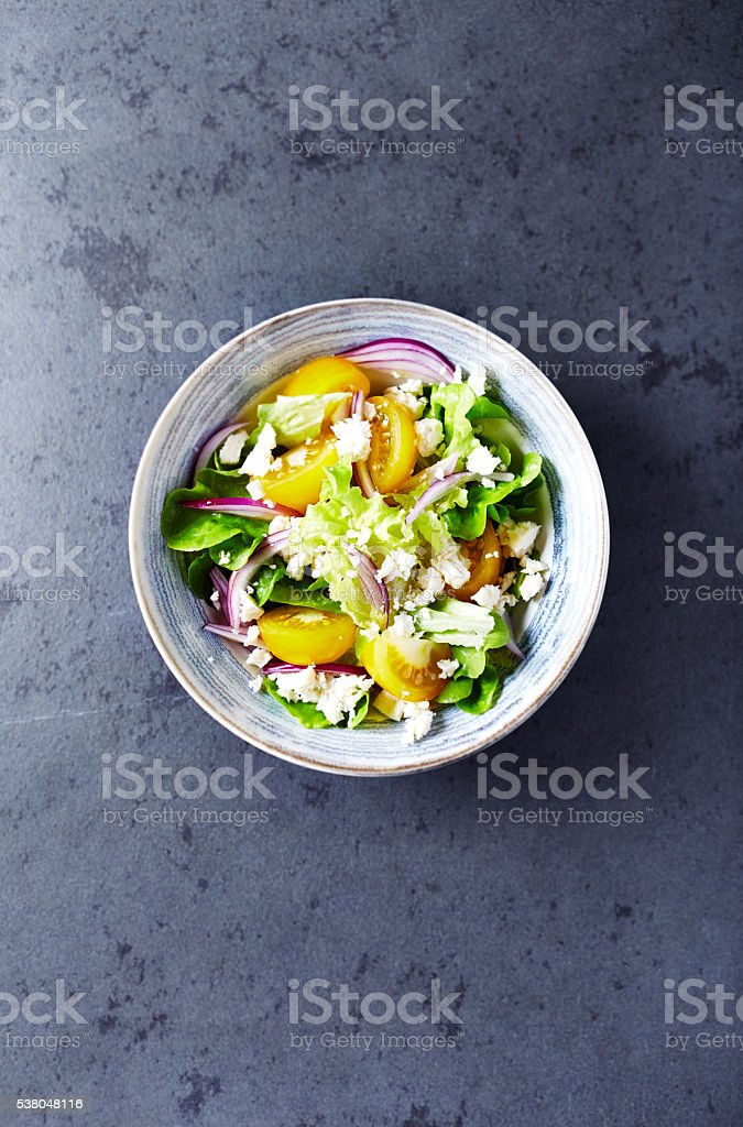 Yellow Tomato Salad with Feta Cheese stock photo