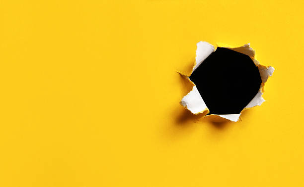 Yellow Torn Paper hole, horizontal Yellow and white paper with torn hole. Very horizontal format to fit billboard. Breakthrough.Shot with a medium format camera and digital back. burwellphotography stock pictures, royalty-free photos & images