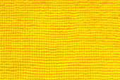 yellow towel close-up fabric and texture background.