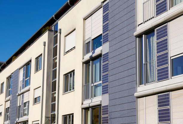 Yellow townhouses with solar panels at their facades stock photo
