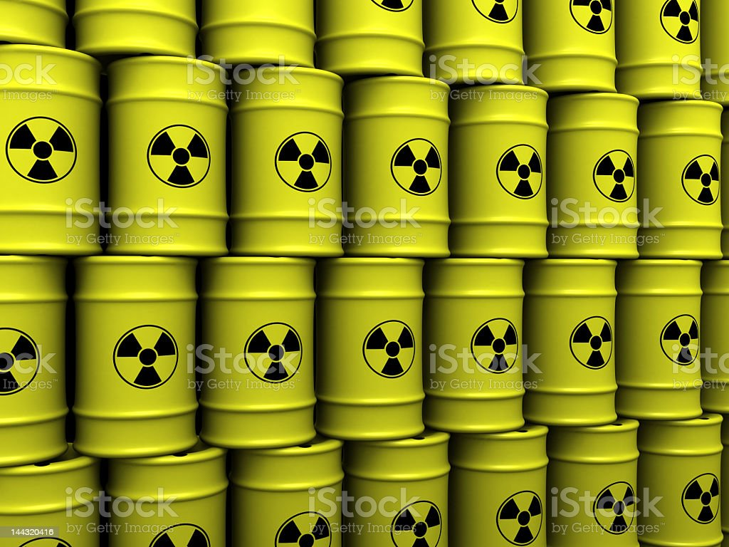 Yellow toxic waste barrels stacked on top of each other stock photo