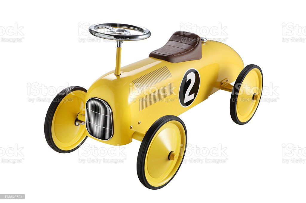 A yellow toy car with big wheels and a number 2 on the side stock photo