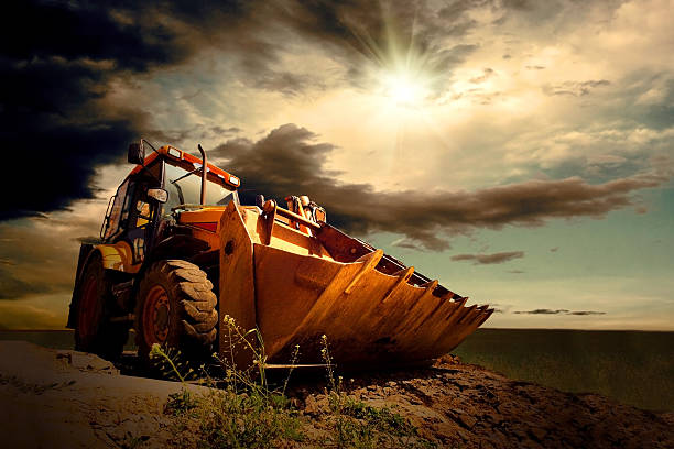 Yellow tractor on sky background stock photo