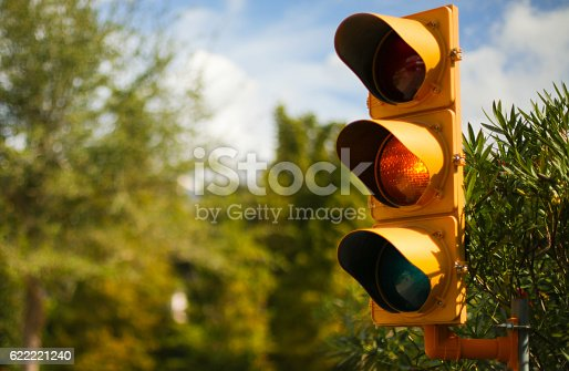 Yellow traffic stop light with copyspace