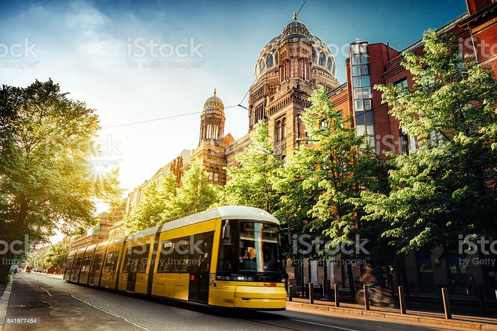 yellow train passing synogoge in Berlin Oranienburger Strasse stock photo
